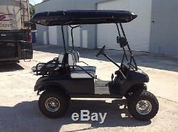 Black club car DS 4 seat Passenger golf cart electric lifted